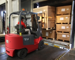 Forklift driver unloading LTL shipping container